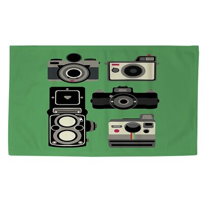 Cameras Green Area Rug by Thumbprintz