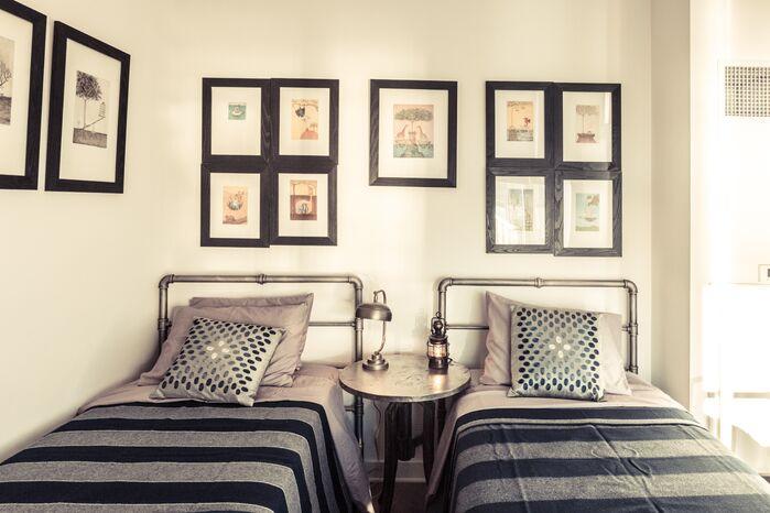 Industrial Bedroom photo by Marie Burgos Design