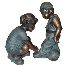 Girl Fixing Boy's Shoe Lace Statue