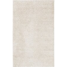 Taz Ivory Solid Area Rug