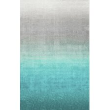 Sivir Turquoise Area Rug