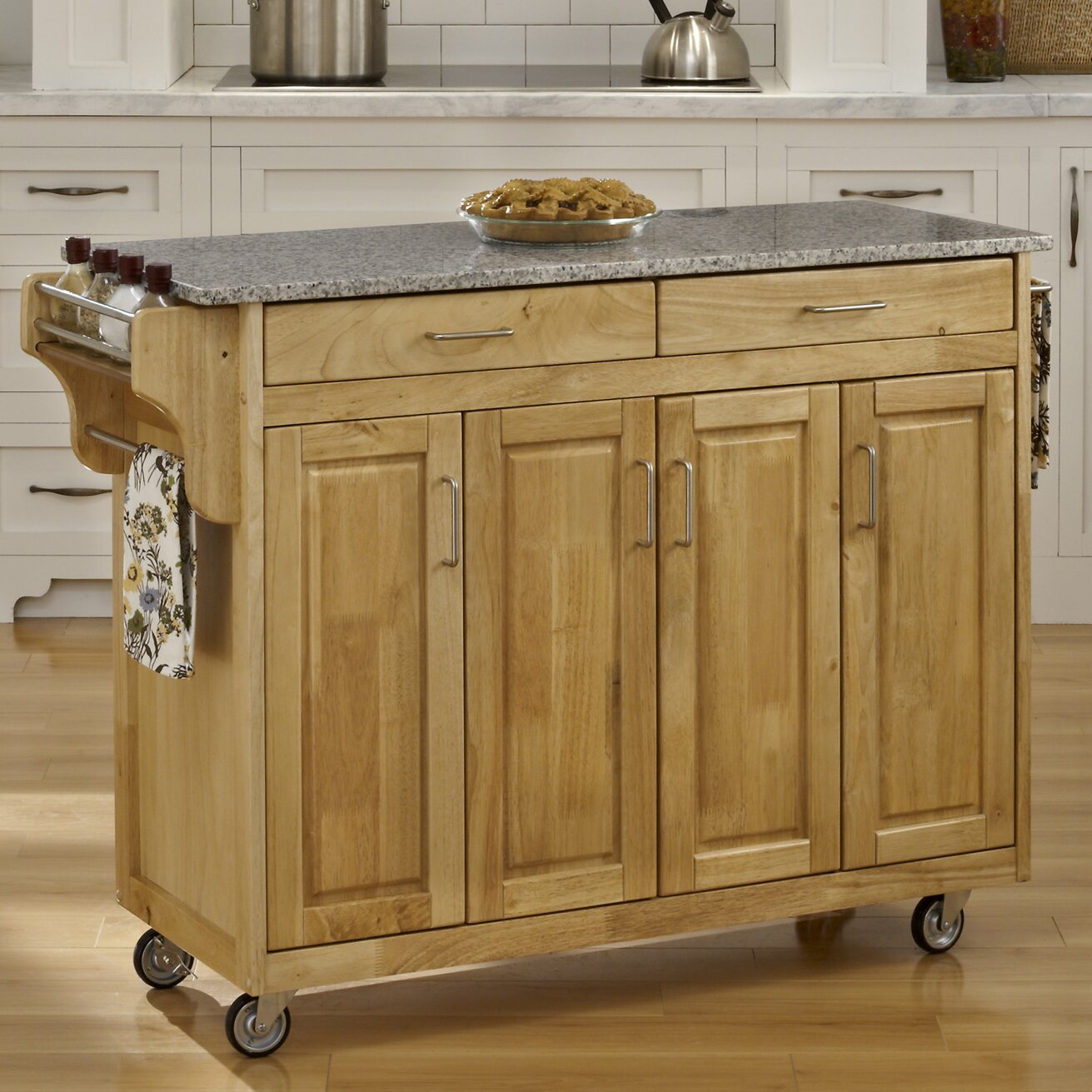 Home styles create a cart kitchen island with granite top for Marble topped kitchen island